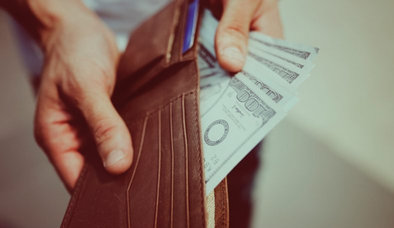 person holding and showing 100 dollar bills from leather wallet 788x456 - person-holding-and-showing-100-dollar-bills-from-leather-wallet